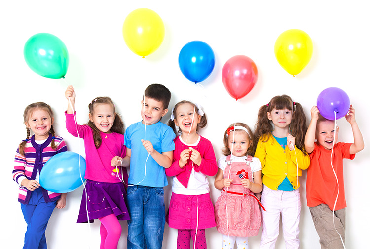 kids at a birthday party taking a picture